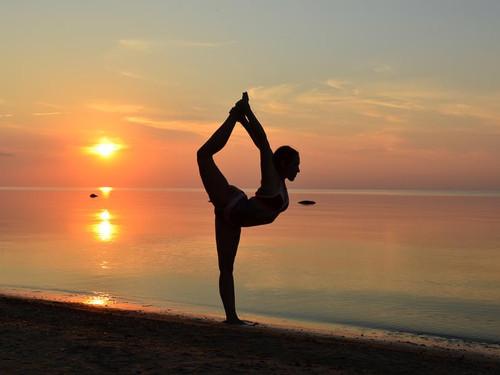 beach-yoga-pose-in-sand-at-sunset.jpg