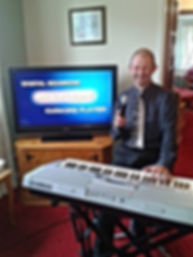 me playing the keyboard in a room of a care home entertaning