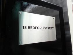Steel plaque door sign