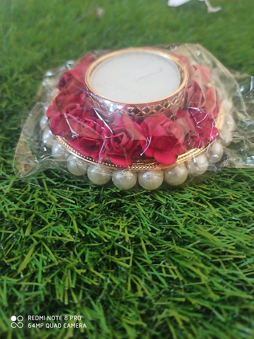 Beautiful T lights with rose and pearl decoration on boundary