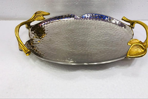 Beautiful metal hammered tray in store with beautifully carved handles