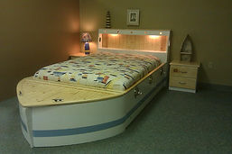 White and blue boat bed and nightstand
