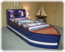 A custom built bed that looks like a boat