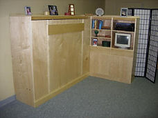 Murphy bed with long leg across the front.