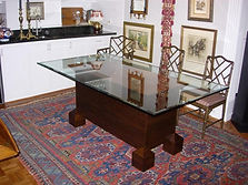 Modern table with glass top and geometrical shapes.