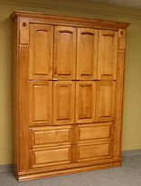 Murphy bed with raised panel doors that fold out to a desk