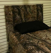 Headboard covered in a camo fabric