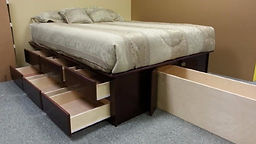 Bed pedestal with drawers open