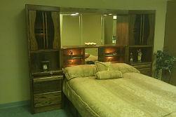 Bedroom wall unit in darker finish