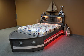 A bed that looks like a batmobile