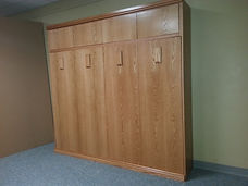 Horizontal Murphy wall bed with added upper cabinet
