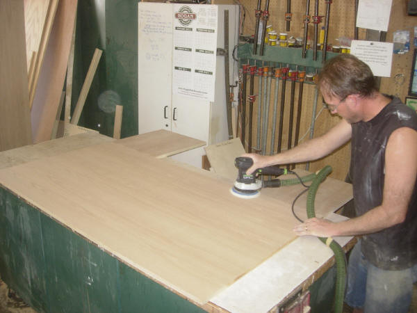 Paul sanding the headboard