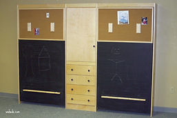 Murphy bed with a chalkboard face, cork board and bookcase