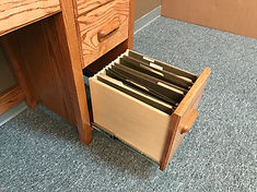 Bookcase with the drink tray pulled out.