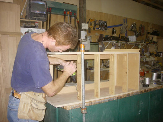 Chris building the chest for the loft bed