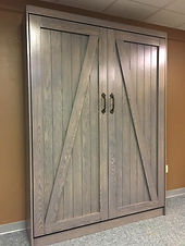 Murphy bed two large doors with a barn door look