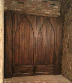 Murphy bed with Gothic arch style doors on the face.