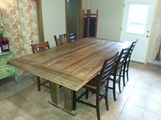 Large farm table made from reclaimed lumber.