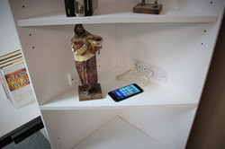 Charging station in back of bookcase