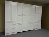 White Murphy bed with fold out desk and bookcases