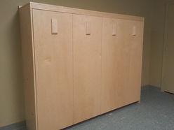 Murphy wall bed turned sideways with bi-fold door design