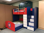 Loft or bunk with a baseball cubs theme