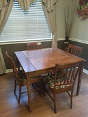 Solid oak dining table with bread board ends.