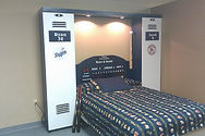 A folding wall bed designed to look like both a Dodgers and Red Sox Locker