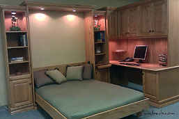 Murphy bed shown in the open position and a desk