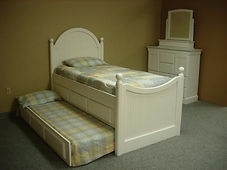 Four poster bed with trundle