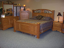 four poster bed with raised panels.