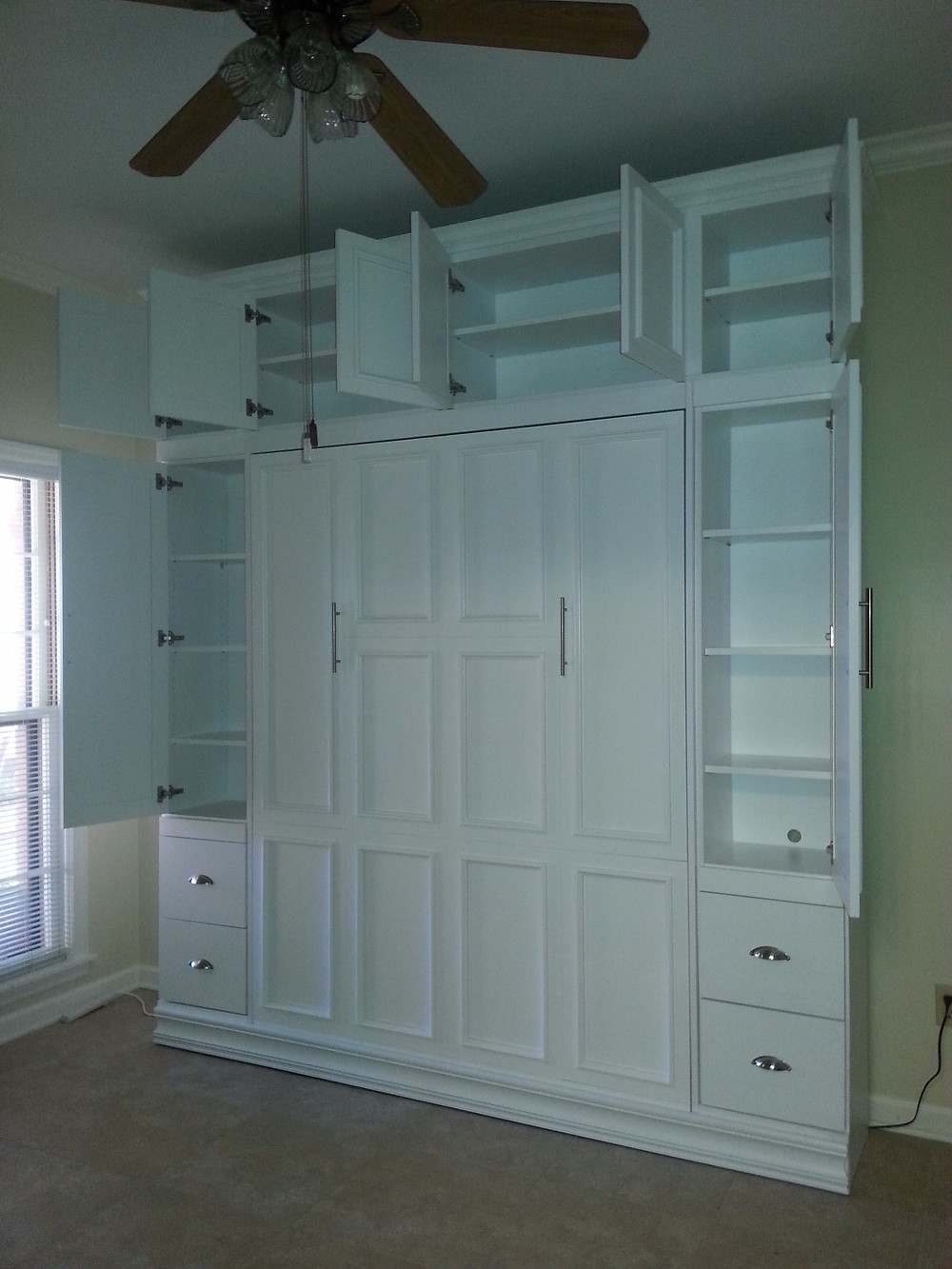 Murphy Bed showing cabinet space