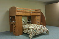 bunk with stairs, desk, bookcase and chest