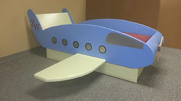 Blue airplane bed on a pedestal