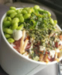 Poke bowl with edamame drizzled with swe
