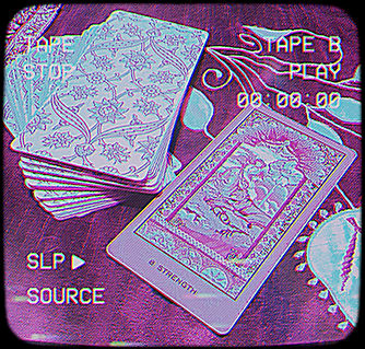Tarot Online. Photo ID: a photo of a deck of Tarot Cards, the Strength Card pulled out.