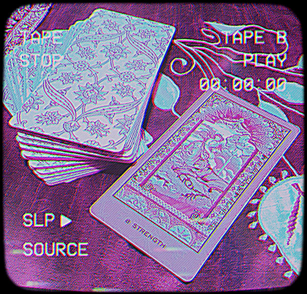 Online Tarot Reading. Photo ID: a deck of tarot cards with the strength card out.