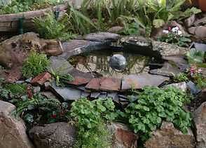 realizzazione di un mini laghetto per giardino residenziale a Cagliari