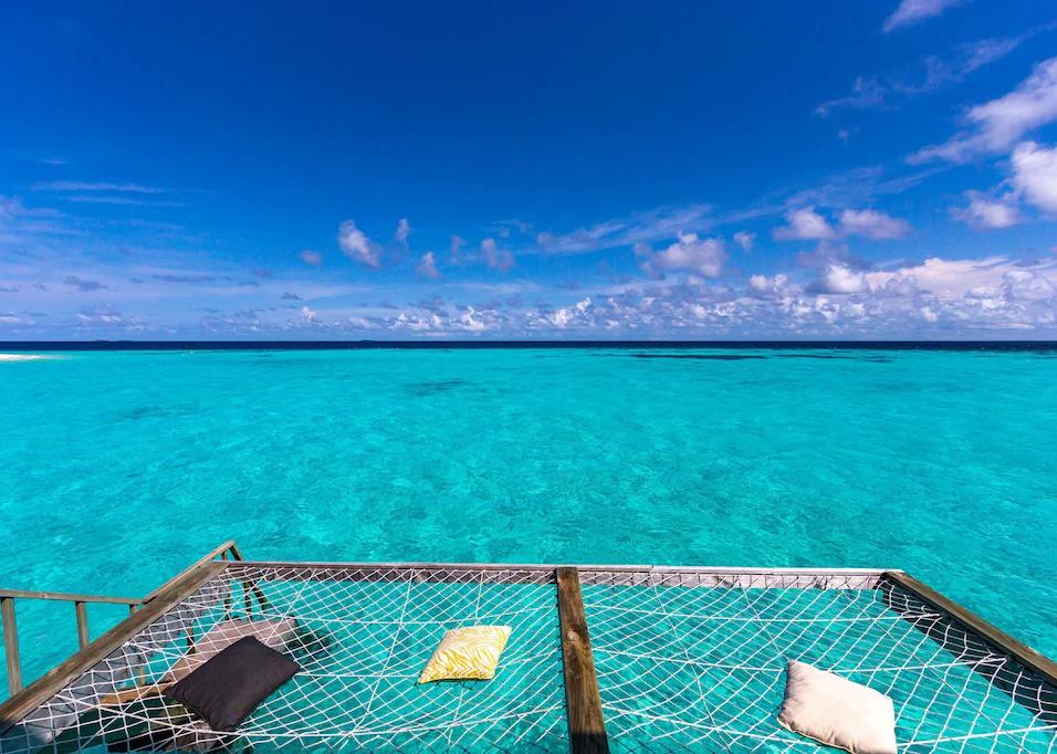 net lounges over ocean.webp