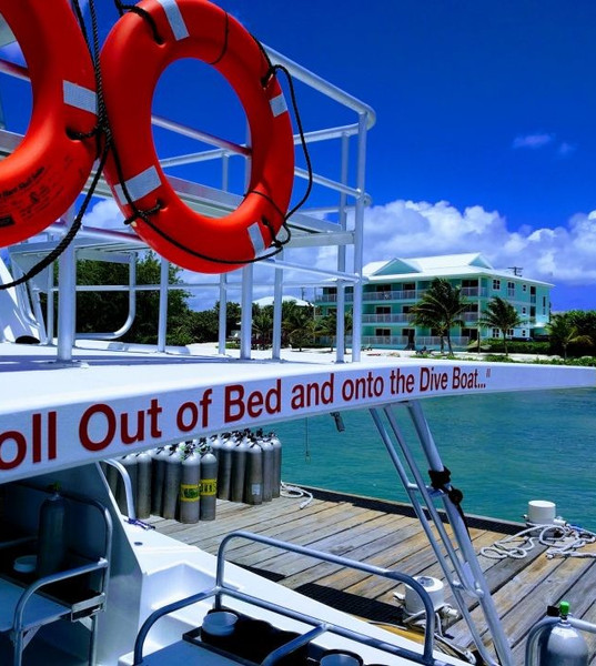 Compass Point Boat with resort in the background roll out of bed.jpeg
