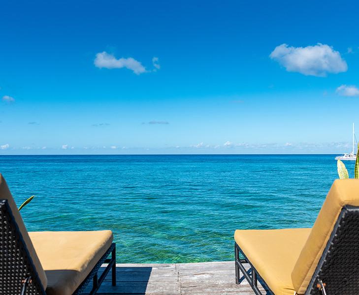 Villa-Eden-lounge chairs on dock.jpeg