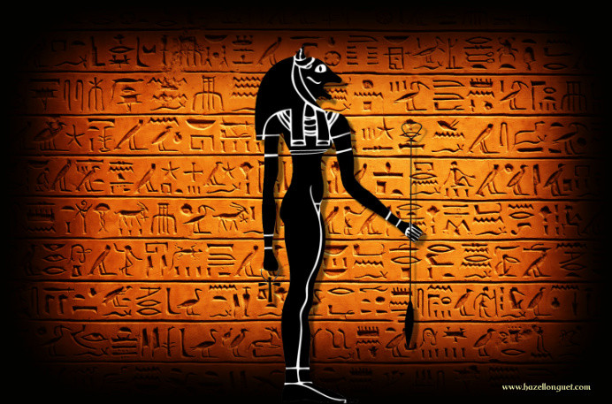 Image of Goddess Bastet against a hieroglyphics wall