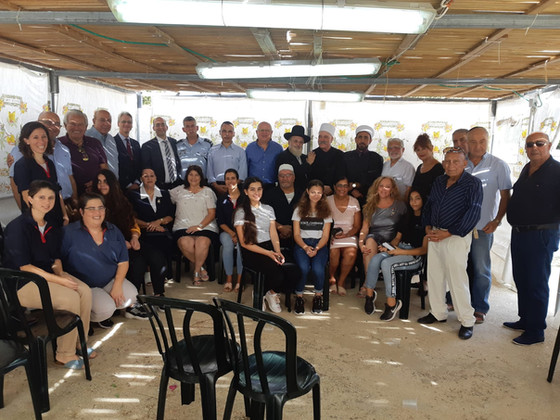 Educators' Kibbutz Meets Religious Communities at Chief Rabbi's Sukkah of Peace