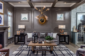 Perfect balance. Not just in the arrangement of decor, but also the fixtures. Bet you didn't notice the walls and floor boards were all painted the same color. The monochromatic look is balanced with the wainscoting and dramatic ceiling.
