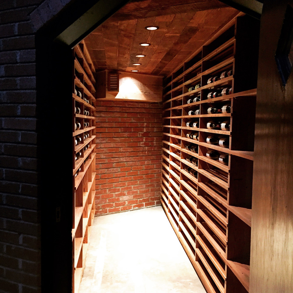 Spruce - wine cellar in a Lloyd Wright mid-century home remodel. See more design and organizing inspiration at www.spruceyourspace.com