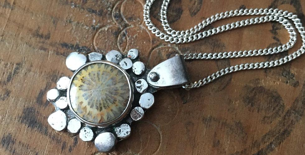 Fossilized coral pendant