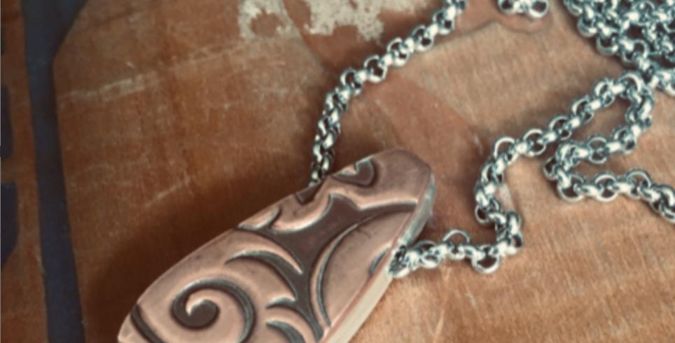 Patterned copper hollow form pendant