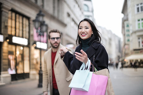 woman-in-black-coat-holding-a-shopping-b