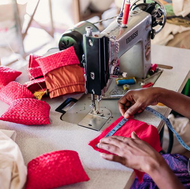 Woman making palm leaf pouches