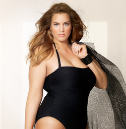 Beautiful%20plus%20size%20model%20wearing%20swimsuit%20and%20sunglasses._edited.jpg